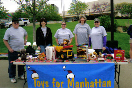 John, Tiffany, Julie, Barb, and Judy collecting toys in front of Bramlage Colliseum