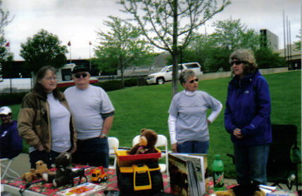 Carol, John, Betty, and Barb collecting toys in front of Bramlage Coliseum